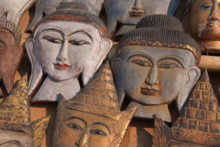 weekly market: Carved wooden heads of Buddha,  at a weekly market on Inle Lake,  Myanmar (Burma)