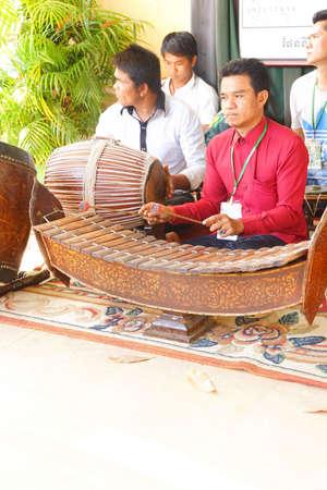 phnom penh: PHNOM PENH, CAMBODIA - FEB 8, 2015 - Musicians play traditional Cambodian instruments,  at the Royal Palace, Phnom Penh,   Cambodia