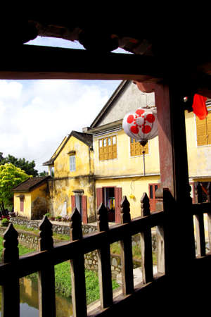 hoi an: Old yellow house, seen from  inside the Japanese Covered Bridge,  Hoi An, Vietnam