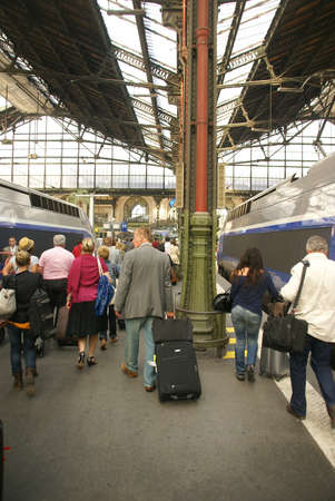 disembark: PARIS - OCT 3, 2011 - Passengers disembark the TGV high speed train at the Gare de Lyon railway station,  on Oct 3, 2011, in Paris, France.