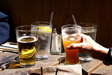 drinks on bar: Glasses of beer and water on a pub table,Port Townsend,Pacific Northwest, Washington