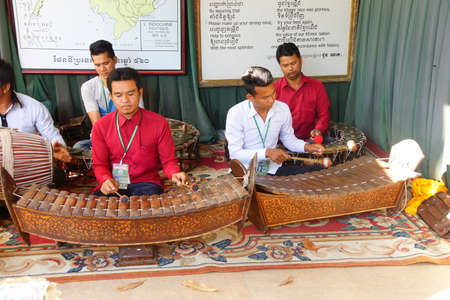 penh: PHNOM PENH, CAMBODIA - FEB 8, 2015 - Musicians play traditional Cambodian instruments,  at the Royal Palace, Phnom Penh,   Cambodia