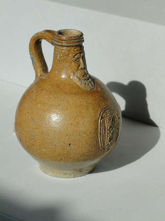 Ancient wine jug with mans head,  at the Ariana Museum, Geneva, Switzerland