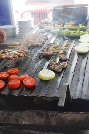 kabob: Grilling kabob skewers, onions and peppers for lunch in restaurant near  Aphrodisias,  Turkey