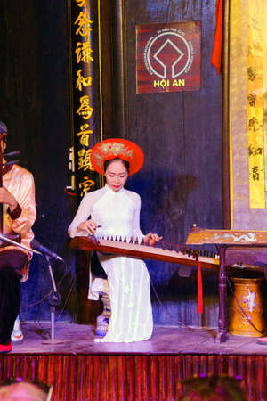 stringed instrument: HOI AN, VIETNAM - FEB 3, 2015 - Woman plays ancient Chinese stringed instrument,  Hoi An, Vietnam Editorial