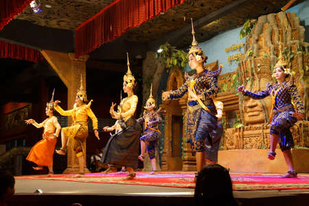 SIEM REAP, CAMBODIA - FEB 14, 2015 - Line of apsara dancers perform at a recital,  Siem Reap,  Cambodia Редакционное
