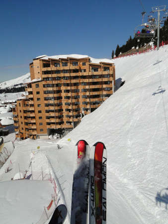 skiers: Ski lift carries skiers  through the town of Avoriaz in the Portes du Soleil, , France
