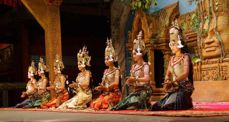 siem reap: SIEM REAP, CAMBODIA - FEB 14, 2015 - Apsara dancers kneel at the end of a performance, Siem Reap,  Cambodia Editorial