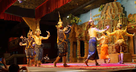 reap: SIEM REAP, CAMBODIA - FEB 14, 2015 - Line of apsara dancers perform at a recital,  Siem Reap,  Cambodia Editorial