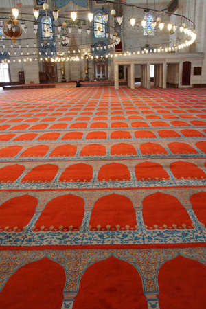 prayer rug: ISTANBUL, TURKEY - MAY 14, 2014 -   Interior of prayer space of the Suleymanie Mosque,  in Istanbul, Turkey