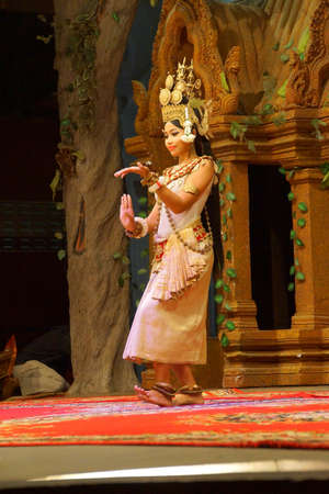 reap: SIEM REAP, CAMBODIA - FEB 14, 2015 - Solo Apsara dancer uses hand gestures to tell a story,  Siem Reap,  Cambodia