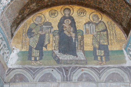 justinian: ISTANBUL, TURKEY - MAY 17, 2014 -Constantine and Justinian make offerings to the Blessed Virgin Mary and her son, Jesus, Byzantine mosaic in the gallery of Hagia Sophia,  in Istanbul, Turkey Editorial