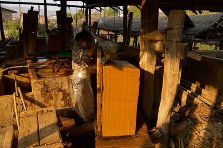 lye: KYAUKME, MYANMAR - FEB 21, 2015 - Making bamboo paper sheets from pulp,  Kyaukme Myanmar (Burma) Editorial