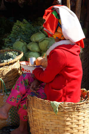 tends: Shan woman tends a vegetable stand at the  weekly wholesale market,  Aung Ban,  Myanmar (Burma)