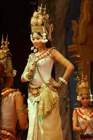 apsara: SIEM REAP, CAMBODIA - FEB 14, 2015 - Solo Apsara dancer uses hand gestures to tell a story,  Siem Reap,  Cambodia
