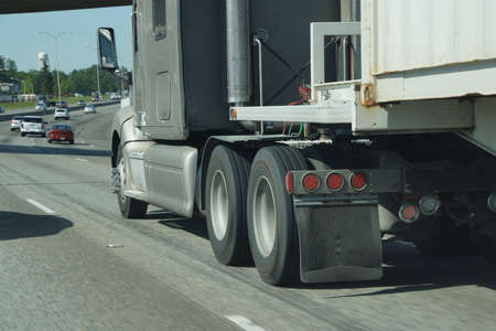 tacoma: Blurred wheels of truck on the freeway near Tacoma, Washington Stock Photo