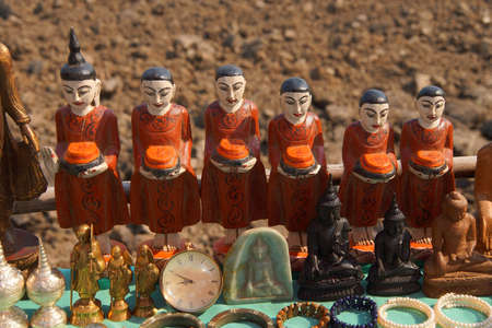 Spirit nats and other Buddhist figurines, at a weekly market on Inle Lake,  Myanmar (Burma)