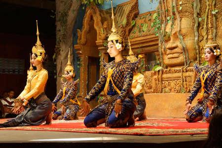 apsara: SIEM REAP, CAMBODIA - FEB 14, 2015 - Apsara dancers kneel at the end of a performance, Siem Reap,  Cambodia Editorial