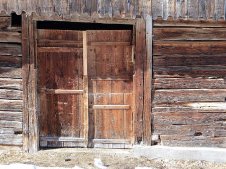 old barn in winter: Old weathered wooden barn and stable, in the alpine village of Chatel, France