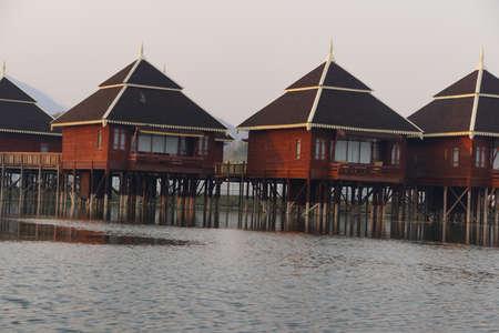 inle: INLE LAKE, MYANMAR - FEB 28, 2015 - Dusk, Floating cottages of Hupin Hotel on  Inle Lake,  Myanmar (Burma) Editorial