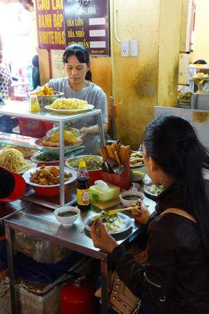 HOI AN, VIETNAM - FEB 3, 2015 - Vietnamese eat lunch at the central market of  Hoi An, Vietnam Editorial