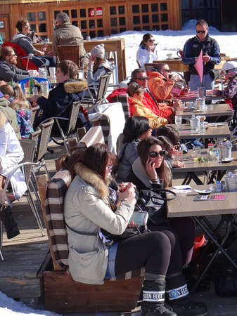 water skiers: AVORIAZ, FRANCE - MAR 3 - Skiers relax on a sunny deck before returning to the slopes  on Mar 3, 2013 in Avoriaz, France