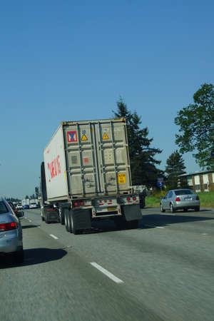 tacoma: TACOMA, WASHINGTON - MAY 8, 2015 - Truck moves with traffic on the freeway  near Tacoma, Washington