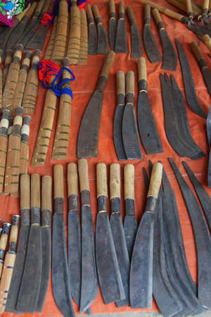 weekly market: Handmade knives and other steel tools for sale  at a weekly market on Inle Lake,  Myanmar (Burma) Stock Photo
