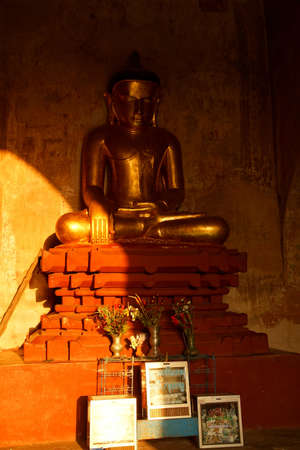 witness: Golden Buddha in Bhumiparsa Mudra position, Calling the Earth To Witness the Truth, Htilominlo Temple, Bagan,  Myanmar (Burma)