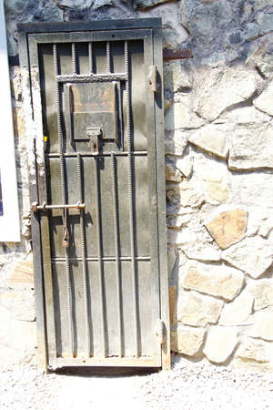 remnants: SAIGON - FEB 5, 2015 - Cell door in Vietnamese prison,  War Remnants Museum, Saigon (Ho Chi Minh City),  Vietnam Editorial