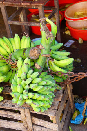 Green bananas and other fruit for sale  at the Central Market of  Hoi An, Vietnam