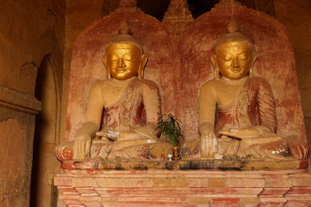 witness: Golden Buddhas in Bhumiparsa Mudra position, Calling the Earth To Witness the Truth, Dhammayangyi Temple, Bagan,  Myanmar (Burma)