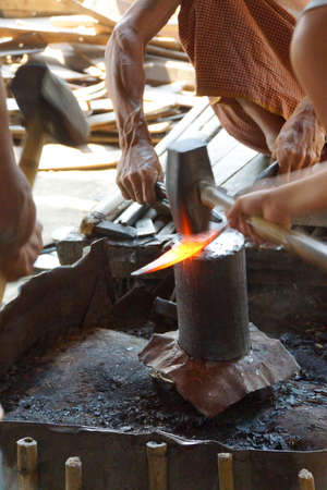 red hot iron: Pounding red hot iron, to make a knife,  Inle Lake,  Myanmar (Burma)