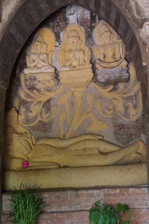 vishnu: Sleeping Vishnu dreaming the creation (Brahma), protection (Vishnu) and destruction (Shiva) of the worldNathlaung Kyaung Temple, Bagan,  Myanmar (Burma)