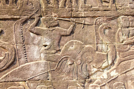 War elephant charging into battle, bas relief sculpture in  Bayon, Angkor Thom,  Cambodia