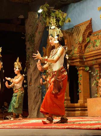 apsara: SIEM REAP, CAMBODIA - FEB 14, 2015 - Apsara dancer in red skirt performs at an evening recital,  Siem Reap,  Cambodia Editorial