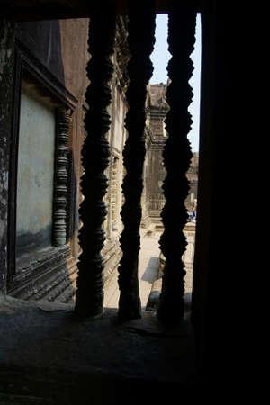 bannister: Stone balustrades give views of the interior galleries of  Angkor Wat,  Cambodia
