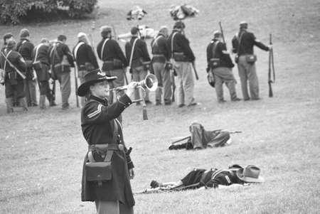 reenactor: CIVIL WAR BATTLE RE-ENACTMENT, PORT GAMBLE, WA - 20 JUN 2009 -  Union bugler playing taps after  the battle