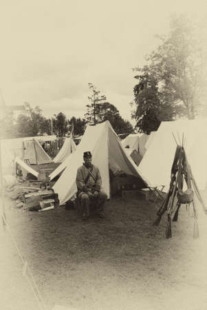 war and military: PORT GAMBLE, WA - JUN 20  - A Confederate sergeant waits by his tent before battle, during a Civil War Battle Re-enactment, on Jun 20, 2009 in Port Gamble, WA. Editorial