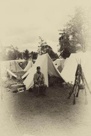 civil war: PORT GAMBLE, WA - JUN 20  - A Confederate sergeant waits by his tent before battle, during a Civil War Battle Re-enactment, on Jun 20, 2009 in Port Gamble, WA. Editorial