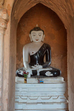 White Buddha in black robe, in Bhumiparsa Mudra position, Calling the Earth To Witness the Truth, Dhammayangyi Temple, Bagan,  Myanmar (Burma)
