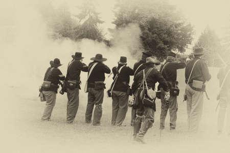 Union infantry line firing a volley,  Civil War Battle Re-enactment,  Port Gamble, WA Editorial