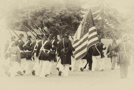 Union troops marching in column formation,   Civil War Battle Re-enactment,  Port Gamble, WA