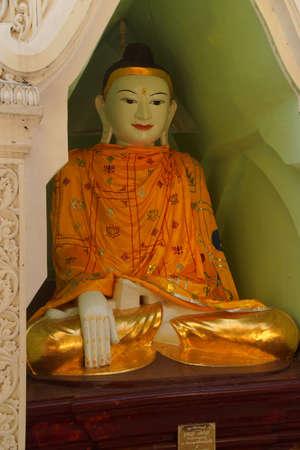 Buddha in Bhumiparsa Mudra position, Calling the Earth To Witness the Truth, Shwedagon Pagoda Yangon (Rangoon),  Myanmar (Burma)