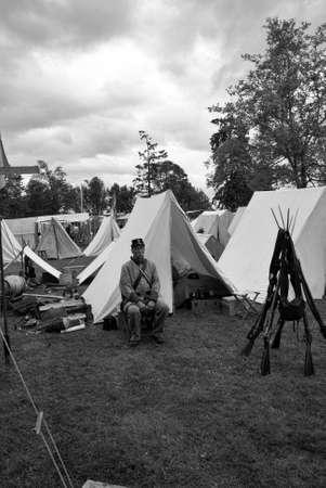 reenactor: PORT GAMBLE, WA - JUN 20  - A Confederate sergeant waits by his tent before battle, during a Civil War Battle Re-enactment, on Jun 20, 2009 in Port Gamble, WA. Editorial