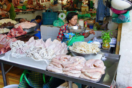 offal: SAIGON - FEB 5, 2015 - Selling pigs ears and other organ offal meat , Saigon (Ho Chi Minh City),  Vietnam