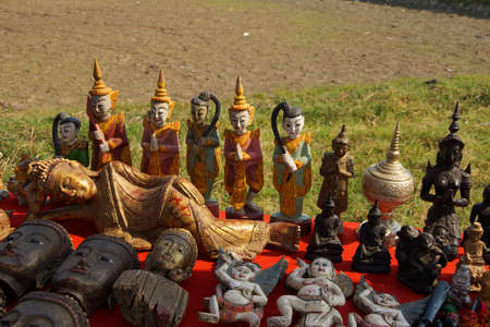 nat: Spirit nats and other Buddhist figurines, at a weekly market on Inle Lake,  Myanmar (Burma)