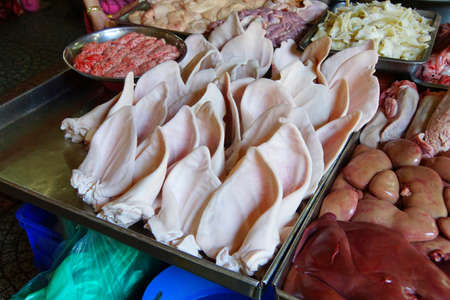 offal: Pigs ears and other organ offal meat , Ben Thanh market, Saigon (Ho Chi Minh City),  Vietnam Stock Photo