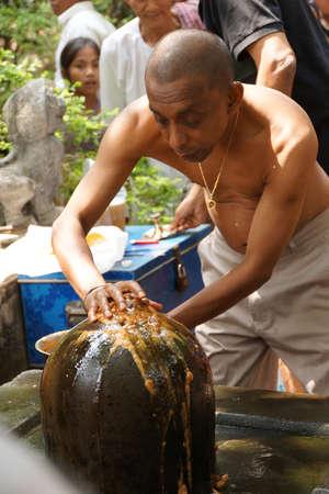 puja: PHNOM KULEN, CAMBODIA - FEB 15, 2015 - Brahmin priest offers puja at large shiva lingam,  Phnom Kulen, Cambodia