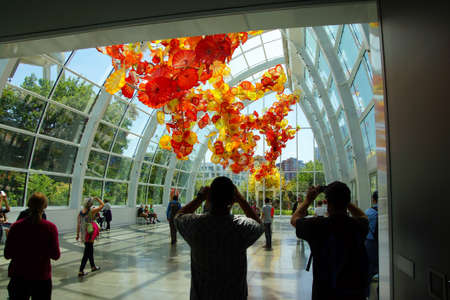 chihuly: SEATTLE - JUL 23, 2015 - Tourists admire the Glass flowers in the  conservatory sunlight of the Chihuly Garden and Glass Museum,  Seattle, Washington Editorial